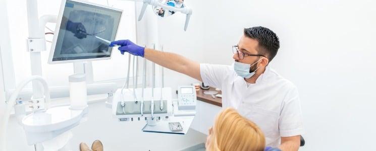 Dentist explaining xrays to patient   Dentist New York